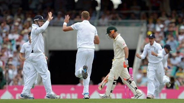Stuart Broad celebrates taking the wicket of David Warner in Sydney (AFP)
