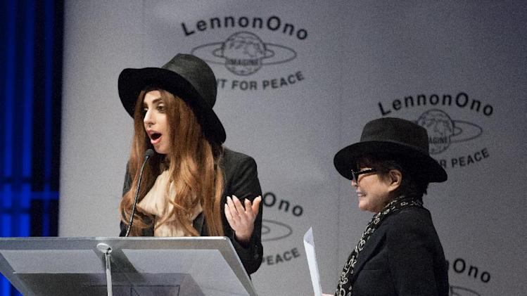 Yoko Ono, right, stands alongside performer Lady Gaga, as she delivers a speech after receiving a Lennon Ono Grant For Peace award in Reykjavik, Tuesday, Oct. 9, 2012. Lady Gaga was presented the award for her social activism. (AP Photo/Brynjar Gauti)