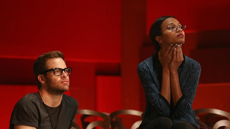 Actors Chris Pine, left, and Zoe Saldana watch rehearsals for the 85th Academy Awards in Los Angeles, Saturday, Feb. 23, 2013. The Academy Awards will be held Sunday, Feb. 24, 2013. (Photo by Matt Sayles/Invision/AP)