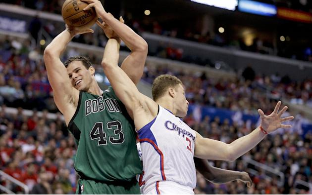 Boston Celtics forward Kris Humphries, left, pulls a rebound away from Los Angeles Clippers forward Blake Griffin during the second half of an NBA basketball game in Los Angeles, Wednesday, Jan. 8, 20