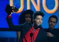 "Winner for Best Pop Vocal Album ""Unorthodox Jukebox"" Bruno Mars accepts his trophy during the 56th Grammy Awards at the Staples Center in Los Angeles, California, January 26, 2014"