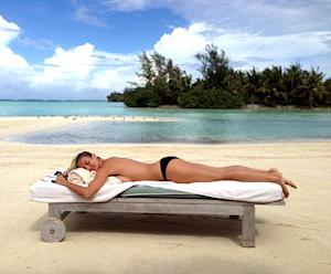 Heidi Klum Sunbathes Topless, Flashes Sideboob on Tropical Vacation: Picture