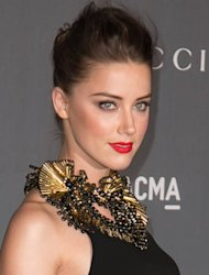Amber Heard falls over on stage in New York