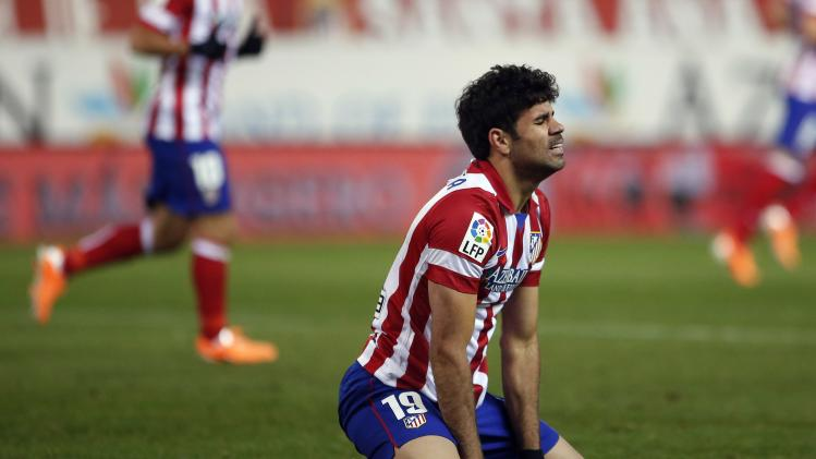Atletico Madrid's Costa reacts during their Spanish First Division soccer match after a missed scoring opportunity against Sevilla at Vicente Calderon stadium in Madrid