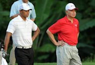 Handout picture. Tiger Woods, left, and Malaysian Prime Minister Najib Razak look on during the pro-am of the 6.1-million-dollar CIMB Classic golf tournament at The Mines Resort and Golf Club in Kuala Lumpur. The event sanctioned by the Asian Tour and PGA Tour will be played from October 25 to 28