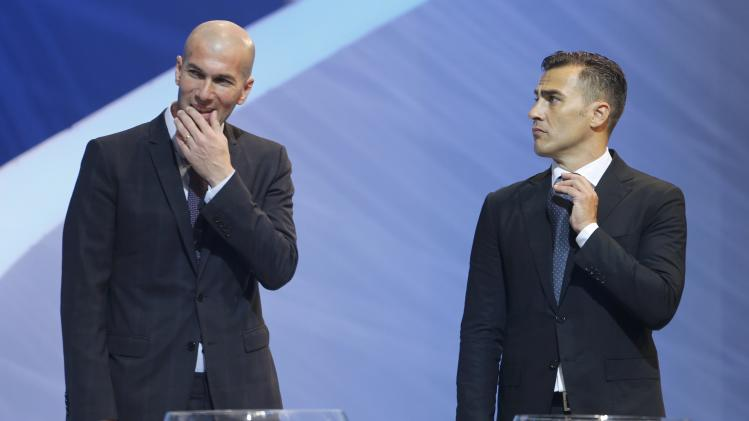 Zidane and Cannavaro look on, during the draw for the 2014 World Cup in Sao Joao da Mata