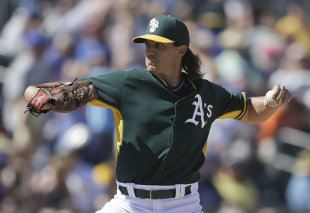 Barry Zito works vs. the Cubs in the fourth inning. (AP)