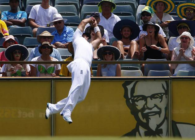 England's Bresnan takes a catch over the boundary on a six hit by Australia's Watson during the fourth day of the third Ashes test cricket match in Perth