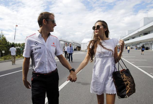 McLaren Formula One driver Jenson Button of Britain and his girlfriend, Japanese-Argentine model Jessica Michibata, arrive at the Suzuka circuit in Suzuka