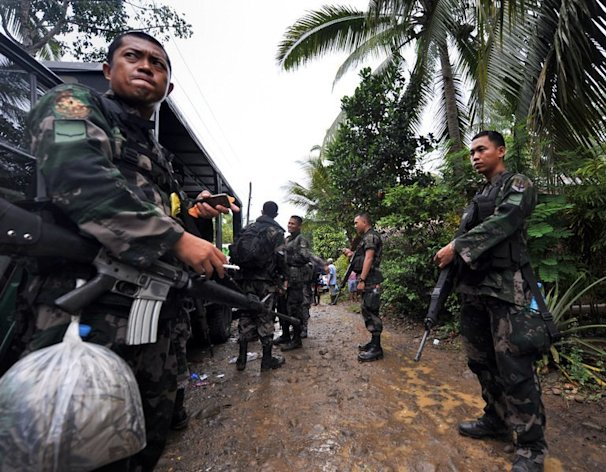 This file photo shows members of a police special action force manning a checkpoint on the southern Philippine island of Mindanao, on December 12, 2009. Six people were killed and more than two dozen wounded when a bomb exploded at a restaurant in a town on Mindanao late on Friday, July 26, 2013