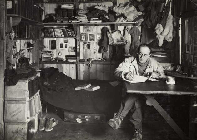 Captain Scott at work in his hut ©H Ponting photograph, Pennell collection Canterbury Museum NZ