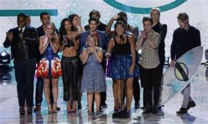"File photo of the cast of television series ""Glee"" accepting the Choice TV Show: Comedy Award at the Teen Choice Awards in Universal City"