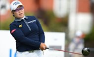Jiyai Shin of Korea plays her tee shot to the third during the second round of the Womens British Open golf tournament at the Royal Liverpool Golf Club in Hoylake, northern England