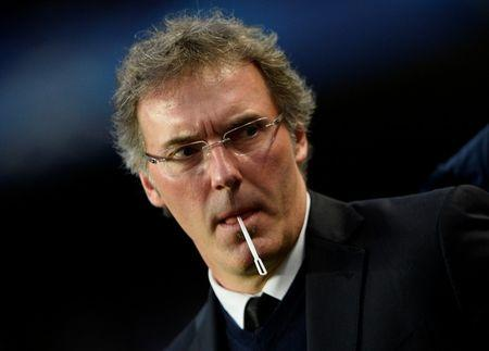 Paris St Germain's coach Blanc is seen before his team's Champions League quarter-final second leg soccer match Chelsea at Stamford Bridge in London