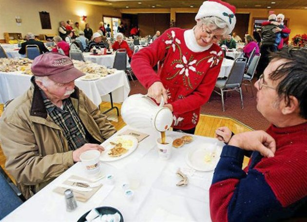 In this 2011 photo, Connie Howe pours coffee for Ronald Read, left, and Dave Smith. (AP Photo/Brattleboro Reformer, File)