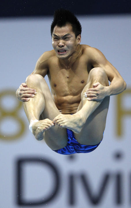 He Chong of China dives during the final of the Men's 3m Springboard at the FINA Diving World Cup at the Olympic Aquatics Centre in London