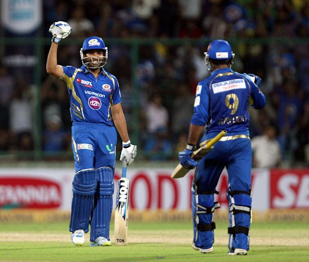 Rohit Sharma and Ambati Rayudu of Mumbai Indians celebrate win during the CLT20 match between Perth Scorchers and Mumbai Indians at Feroz Shah Kotla, Delhi on Oct. 2, 2013. (Photo: IANS)