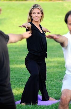 Heidi Klum strikes a yoga pose in New York on July 12, 2011 -- WireImage