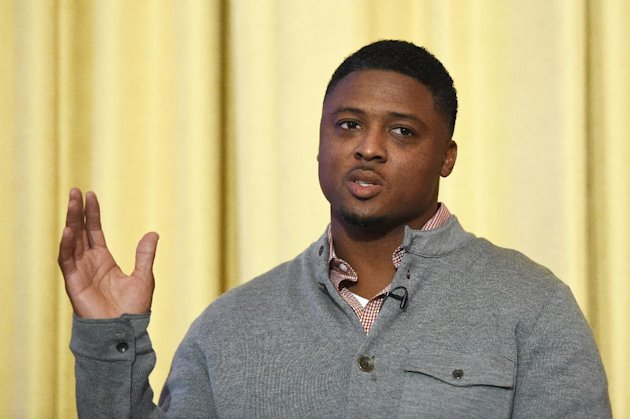 Former NFL player Warrick Dunn speaks during the NFL International Series Fan Forum at a hotel in London, England, Saturday, Oct. 25, 2014. (AP Photo/Tim Ireland)
