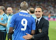 Italian forward Mario Balotelli is comforted by Italian headcoach Cesare Prandelli after the Euro 2012 football championships final match Spain vs Italy on July 1, 2012 at the Olympic Stadium in Kiev. Spain won 4-0. AFP PHOTO / DAMIEN MEYER
