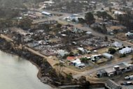 Aerial photo, taken on January 5, 2013, shows the town of Dunalley after bush-fires swept through Tasmania. Australian police said many people remained unaccounted for by Monday but no deaths had yet been recorded in fire-ravaged Tasmania, as the rest of the nation braced for a dangerous heatwave.