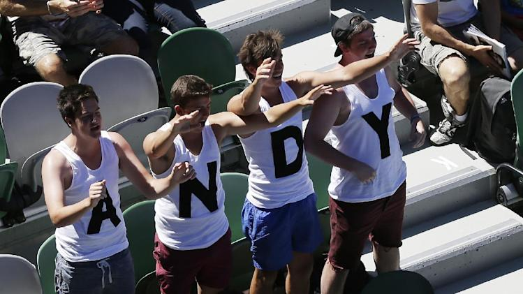 Supporters of Britain's Andy Murray cheer him on during his first round match against Robin Haase of the Netherlands at the Australian Open tennis championship in Melbourne, Australia, Tuesday, Jan. 15, 2013. (AP Photo/Mark Baker)