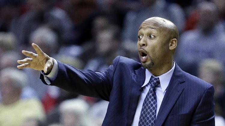 Denver Nuggets coach Brian Shaw calls out from the bench during the second half of an NBA basketball game against the Portland Trail Blazers  in Portland, Ore., Thursday, Jan. 23, 2014. Portland won 110-105
