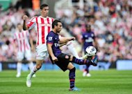 Arsenal midfielder Santi Cazorla (R) vies with Stoke City defender Geoff Cameron (L). Arsenal were held to a second consecutive goalless Premier League draw by Stoke City at the Britannia Stadium