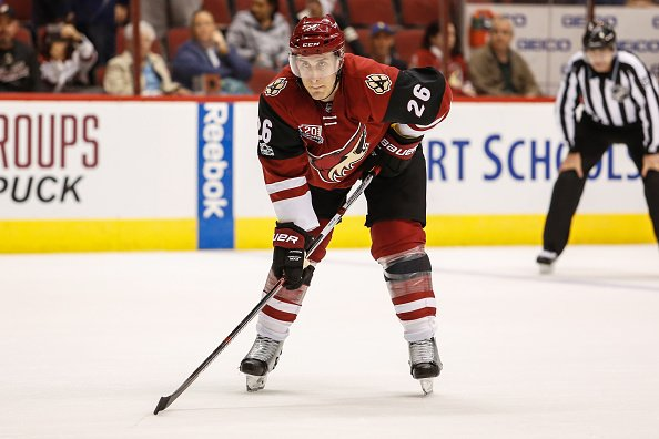 GLENDALE, AZ - JANUARY 23: Arizona Coyotes defenseman Michael Stone (26) gets ready for the face off during the NHL hockey game between the Florida Panthers and the Arizona Coyotes on January 23, 2017 at Gila River Arena in Glendale, Arizona.(Photo by Kevin Abele/Icon Sportswire via Getty Images)