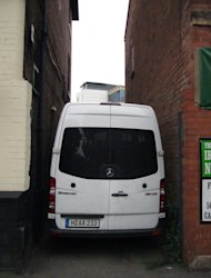 Sometimes we got into some pretty tight situations. This is our parking at the club we played in Nottingham, England.