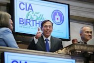 File picture shows Central Intelligence Agency Director David Petraeus (C) preparing to ring the Opening Bell of the New York Stock Exchange as the CIA Commemorates it's 65th anniversary on September 18. The FBI uncovered the affair that led to the resignation of Petraeus while investigating threatening emails sent by his lover to a second woman, US media reported
