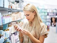 woman looking at beauty product in store