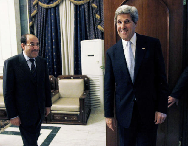 U.S. Secretary of State John Kerry, right, meets with Iraq's Prime Minister Nouri al-Maliki in Baghdad, Iraq, Sunday, March 24, 2013. Kerry made an unannounced visit to Iraq on Sunday and will urge al
