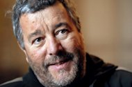 "French designer Philippe Starck has revealed he is working on a ""revolutionary"" project with US computer giant Apple that will come out in time for Christmas"