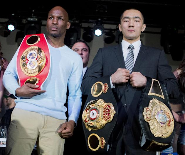 IBF light heavyweight boxing champion Bernard Hopkins, left, and WBA and IBA light heavyweight boxing champion Beibut Shumenov, right, of Kazakhstan, pose with their championship belts during a news c