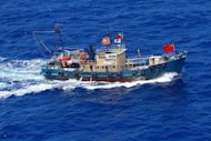 This picture taken by Japan Coast Guard on August 15, 2012 shows a Hong Kong boat in the Japanese territorial waters, in East China Sea near Senkaku or Diaoyu disputed islands