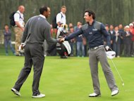 Tiger Woods of the US (L) shakes hands with Rory McIlroy of Northern Ireland in October 2012. McIlroy and Woods were among five players nominated Monday for the PGA Tour player of the year award that will be voted on by their peers