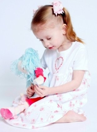 Girl playing with doll.