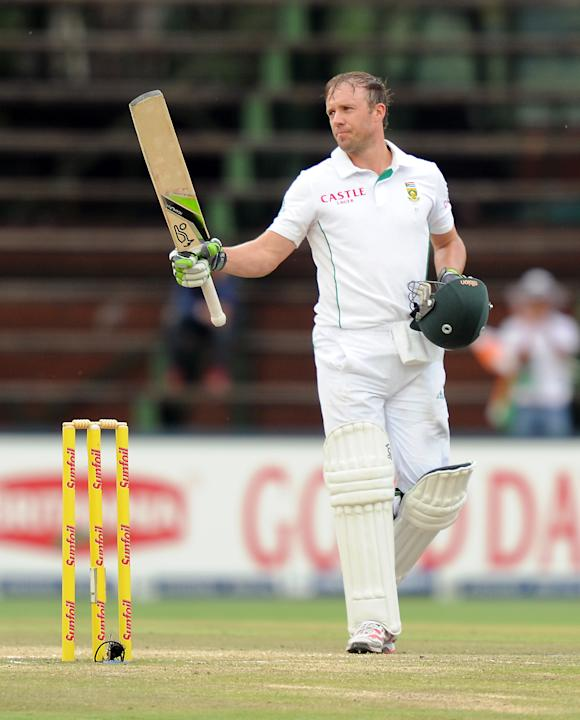 South Africa's batsman AB de Villiers celebrates his century on the 5th day of the first cricket Test match between South Africa and India at Wanderers Stadium in Johannesburg on December 22, 2013. AF