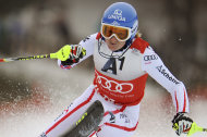 Marlies Schild, of Austria, slaloms past a pole on her way to set the fastest time during the first run of an alpine ski, women's World Cup slalom, in Lienz, Austria, Thursday, Dec. 29, 2011. (AP Photo/Giovanni Auletta)