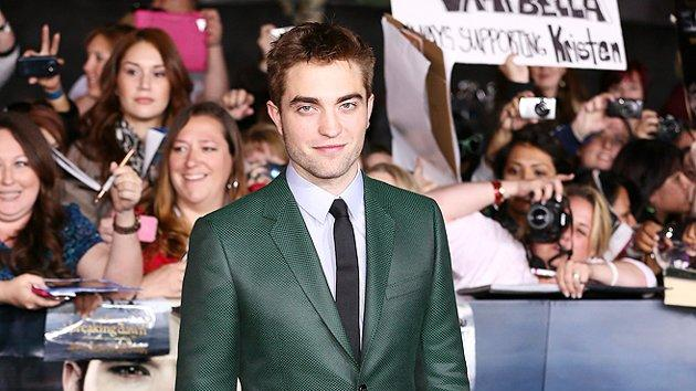 "Few men can pull off a suit in a shade other than your basic black, blue, or gray. Robert Pattinson is one of those men. Are you as in love with the green Gucci suit he wore to the ""Breaking Dawn - Part 2"" premiere as we are? (11/12/2012)"