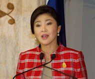 Thailand's Prime Minister Yingluck Shinawatra answers questions during a visit to Government House in Auckland, on March 22, 2013. A lawyer for Yingluck has filed a defamation suit against an influential cartoonist alleging he compared the premier to a prostitute in a facebook post, police said Friday