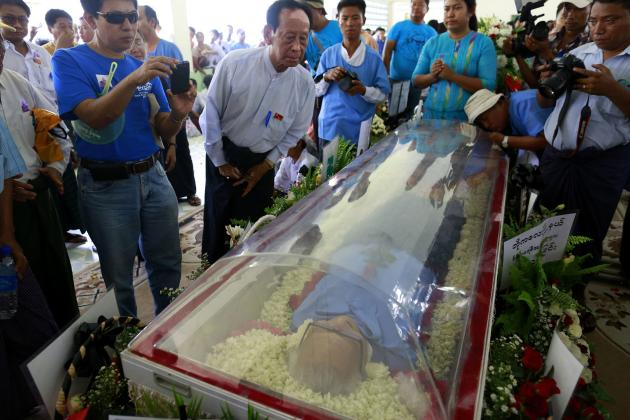 The body of Win Tin is seen in a coffin during his funeral ceremony in Yangon