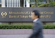 A businessman walks in front of the Mitsubishi UFJ Financial Group (MUFG) headquarters in Tokyo, 2009. Mitsubishi UFJ Financial Group, Japan's biggest bank, said its quarterly net profit slumped 63.5 percent from a year earlier