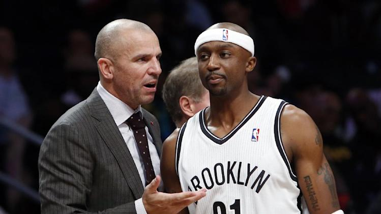Brooklyn Nets coach Jason Kidd talks with  Jason Terry during the Nets' NBA basketball game against the Utah Jazz on Tuesday, Nov. 5, 2013, in New York. Brooklyn defeated Utah 104-88