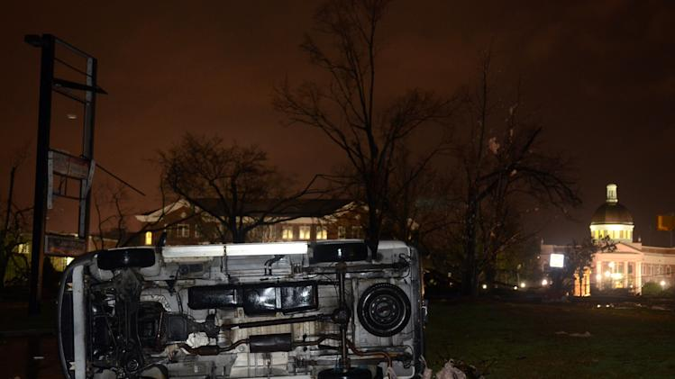 An overturned car lies in front of the University of Southern Mississippi campus in Hattiesburg, Miss., after a possible tornado Sunday, Feb. 10, 2013. (AP Photo/Chuck Cook)