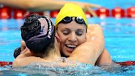 Tough to take: Seebohm congratulates winner Missy Franklin after taking silver in the 100m backstroke