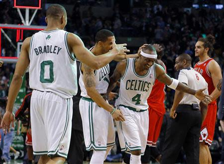 Boston Celtics' Bradley, Lee and Terry celebrate after beating Noah and the Chicago Bulls in their NBA basketball game in Boston