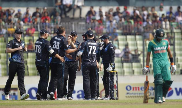 Bangladesh's Anamul Haque leaves the field as New Zealand's fielders celebrate his dismissal during their first ODI cricket match in Dhaka