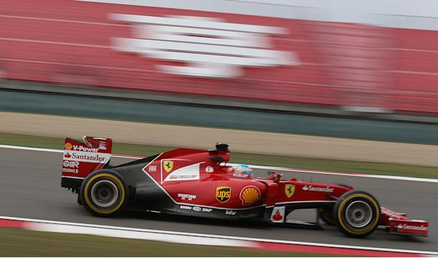 Ferrari driver Fernando Alonso of Spain drives during the practice session for Sunday's Chinese Formula One Grand Prix at Shanghai International Circuit in Shanghai, Friday, April 18, 2014. (AP Ph